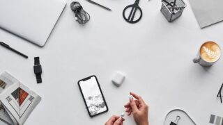 top view photo of person holding earphones